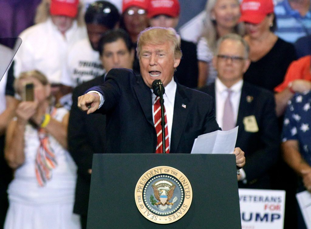 President Donald Trump speaks to supporters at the Phoenix Convention Center during a rally on August 22, 2017 in Phoenix, Arizona. An earlier statement by the president that he was considering a pardon for Joe Arpaio, the former sheriff of Maricopa Count