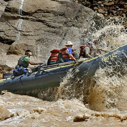 Brian Martinez guides his boat through the whitewater rapids using a motorized raft on the Colorado River in Cataract Canyon in southern Utah. The trip through the canyon is 120 miles long.