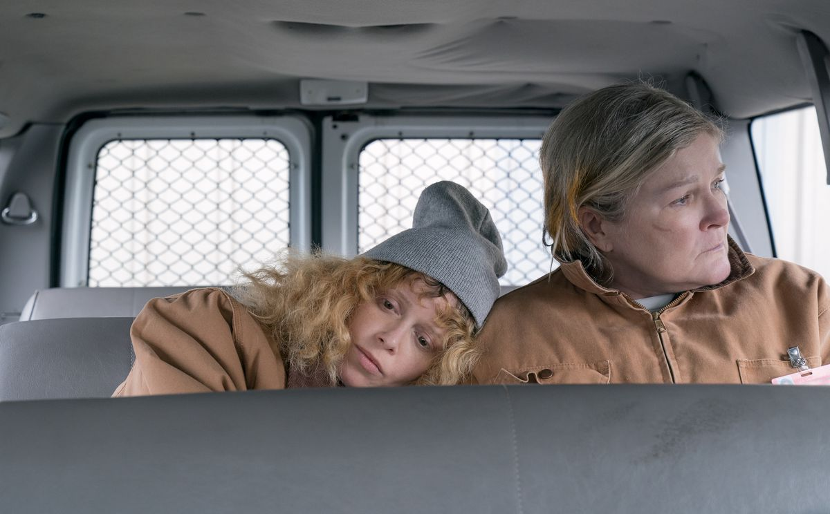 Nicky and Red take a ride in the prison van.