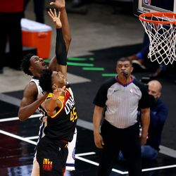 Utah Jazz guard Donovan Mitchell (45) jumps with Memphis Grizzlies forward Jaren Jackson Jr. (13) trying to get the ball Utah Jazz and the Memphis Grizzlies play in game 5 at Vivint Arena in Salt Lake City on Wednesday, June 2, 2021. Utah won 126-110, Utah advances to the second round.