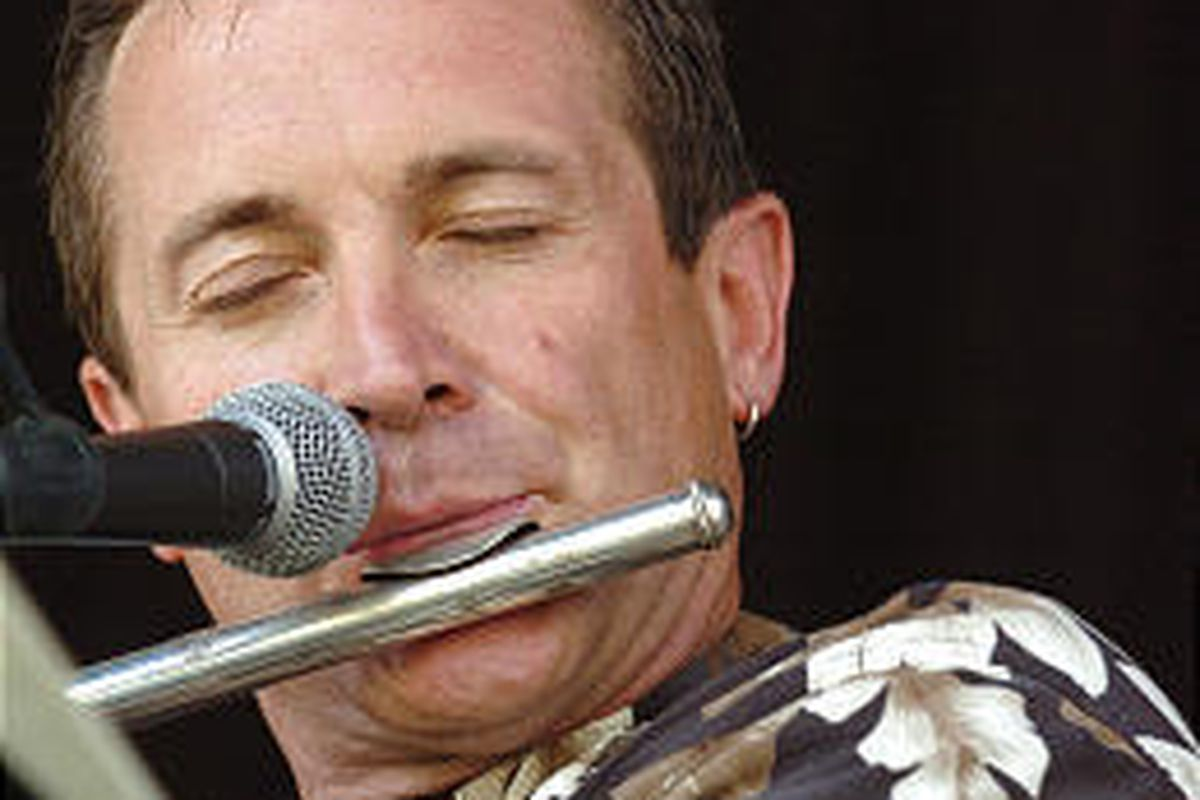 Gary Stoddard of Sandy plays the flute for a lunchtime crowd at the Gallivan Center in Salt Lake City.