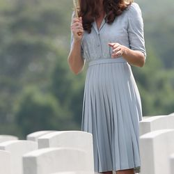 Dressed in pale blue Jenny Packham during a visit to Singapore's Kranji Commonwealth War Cemetery on September 13th, 2012.