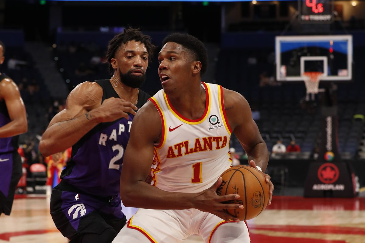 Nathan Knight #1 of the Atlanta Hawks handles the ball against the Toronto Raptors on April 13, 2021 at Amalie Arena in Tampa, Florida.