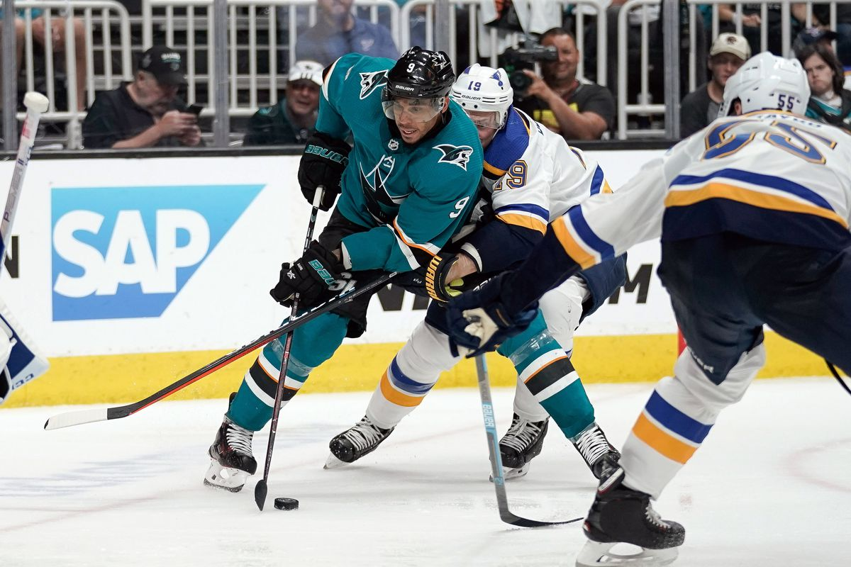May 11, 2019; San Jose Sharks left wing Evander Kane controls the puck against St. Louis Blues defenseman Jay Bouwmeester and defenseman Colton Parayko during the third period in game one of the Western Conference Final of the 2019 Stanley Cup Playoffs at