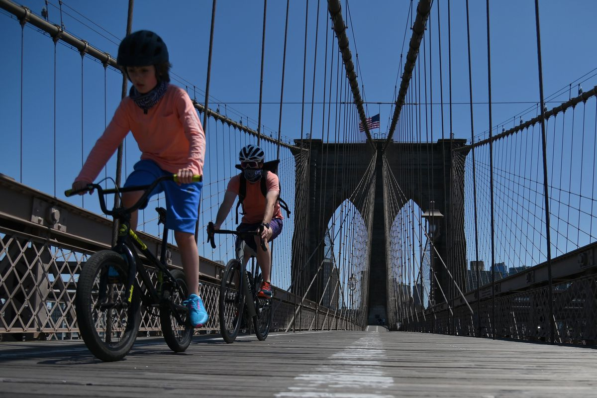 Cyclists on the Brooklyn Bridge.