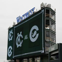 11:25 a.m. The left-field video board showing the old team logos -