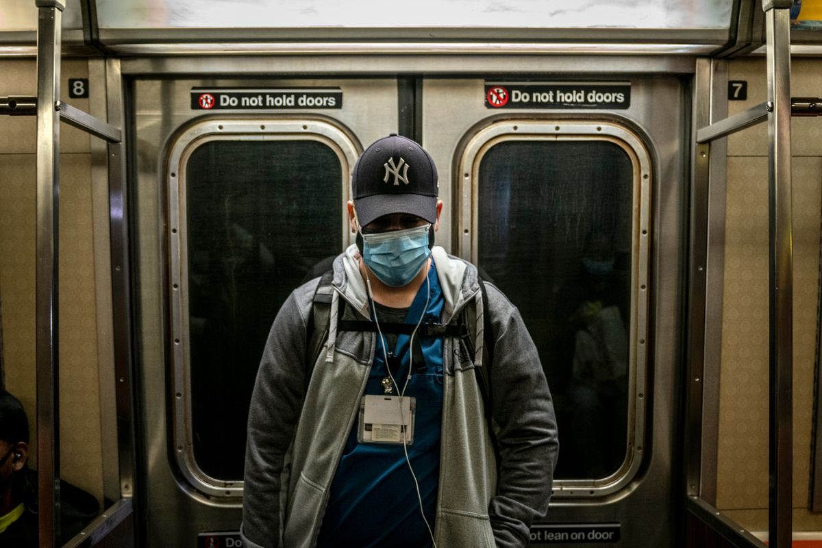 A hospital worker rides a subway in Brooklyn, Oct. 9, 2020.