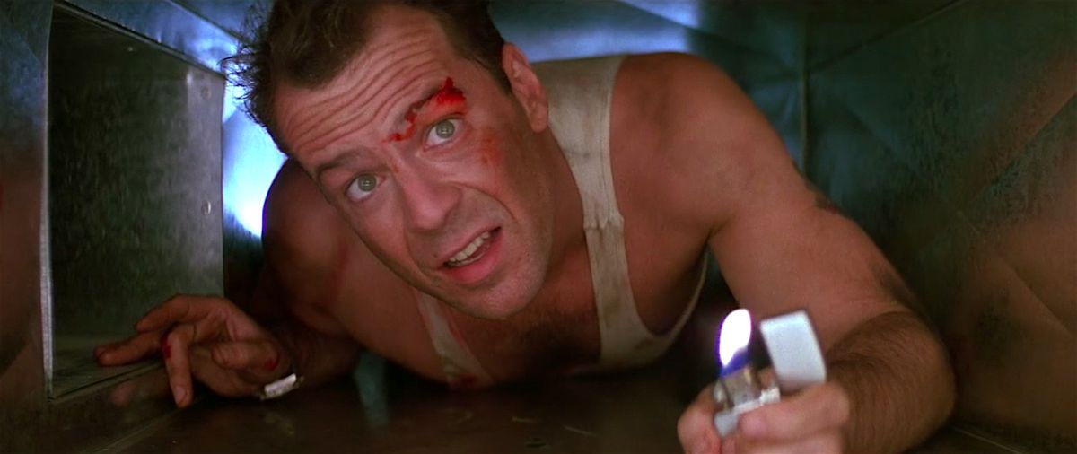 John McClane crawls through an air duct in a still from Die Hard