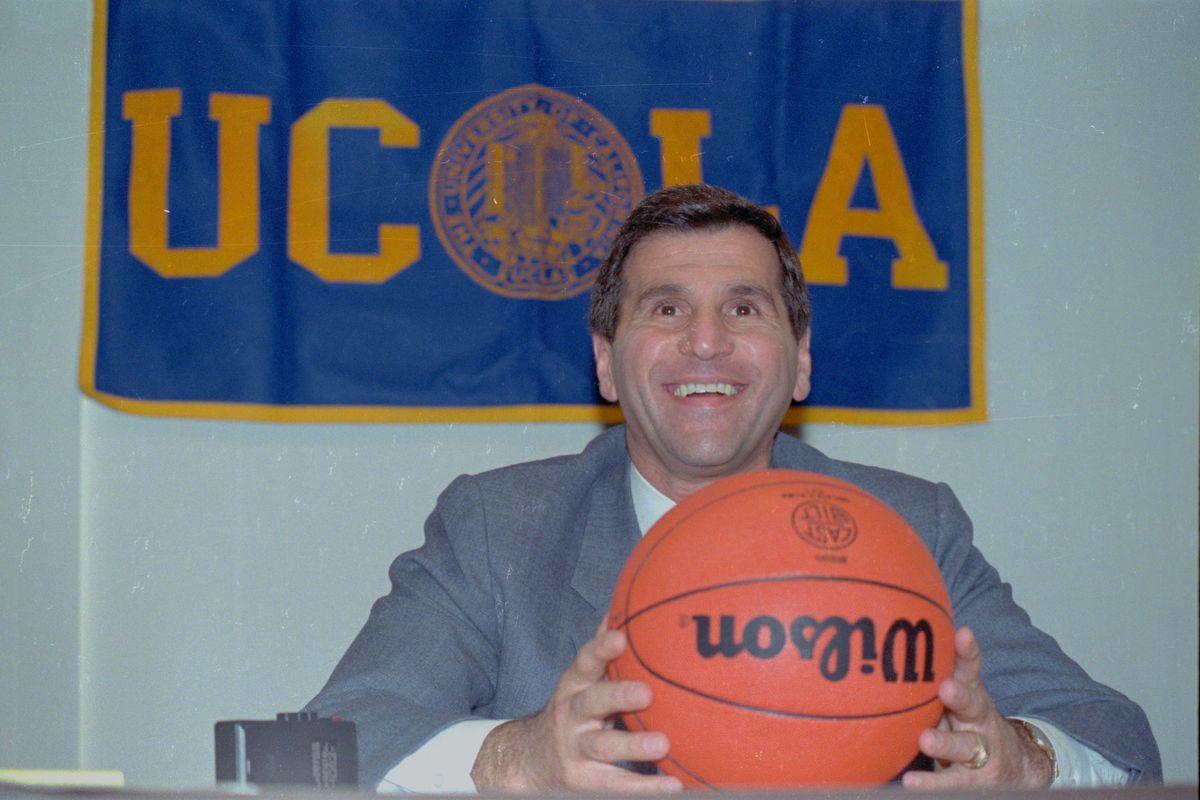 Jim Harrick Posing with Basketball