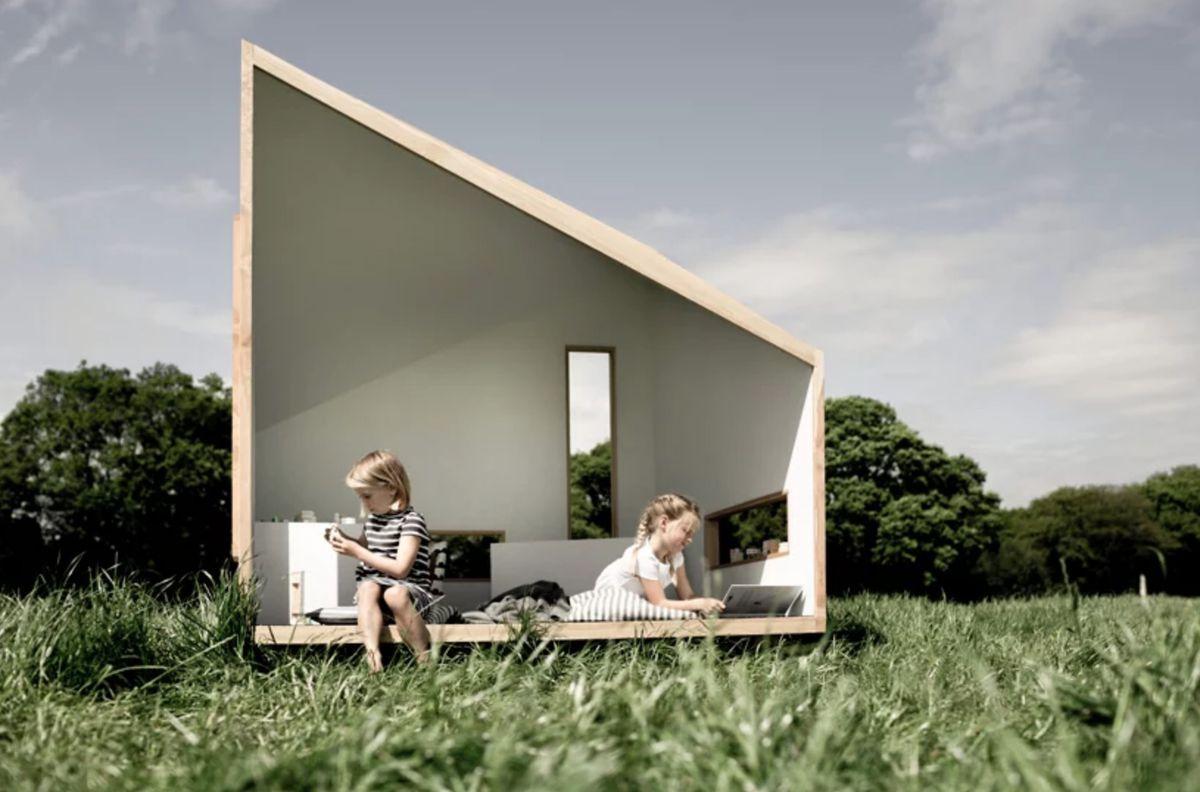 Children reading in wooden cabin
