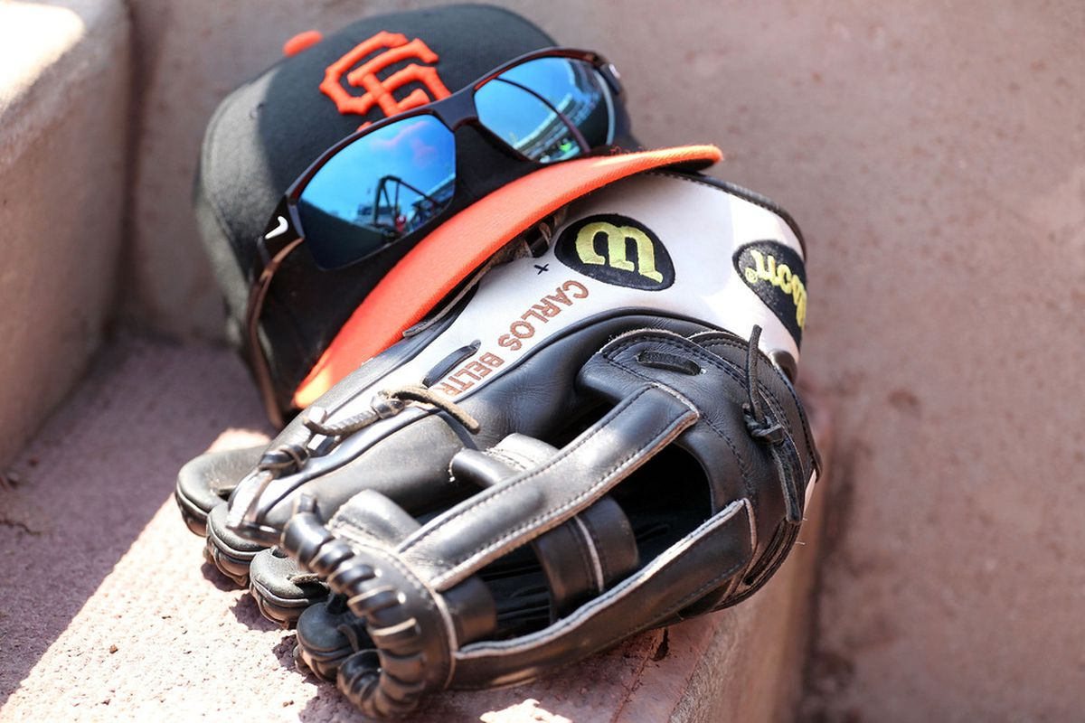 Can the Diamondbacks contain the Giants' offense? (Pictured: a hat, glove, and sunglasses all three of which are tied for the team lead in home runs.)