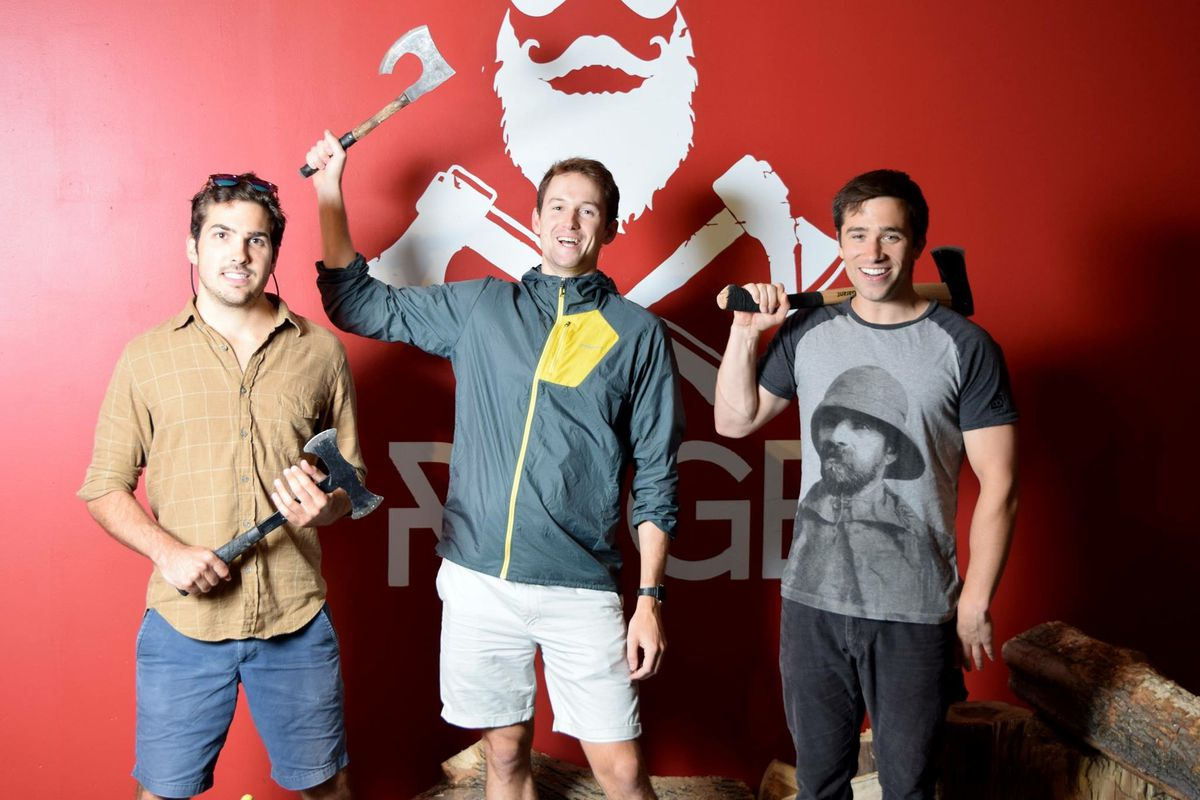 Three of Revolution's four founders on their first ax-throwing trip to Montreal: Greg DiLullo, Chris Greeno, and Dan Doran (from left to right).