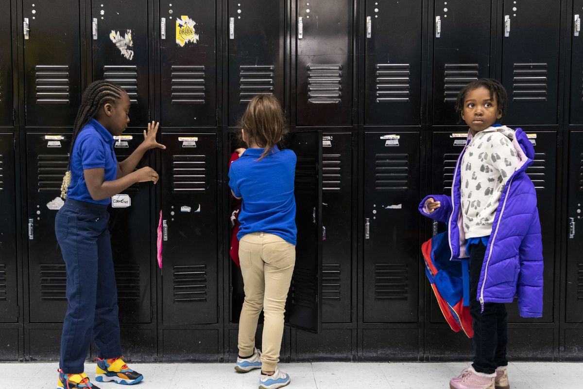 Students put their coats in their lockers at Roswell B. Mason Elementary School on the South Side.