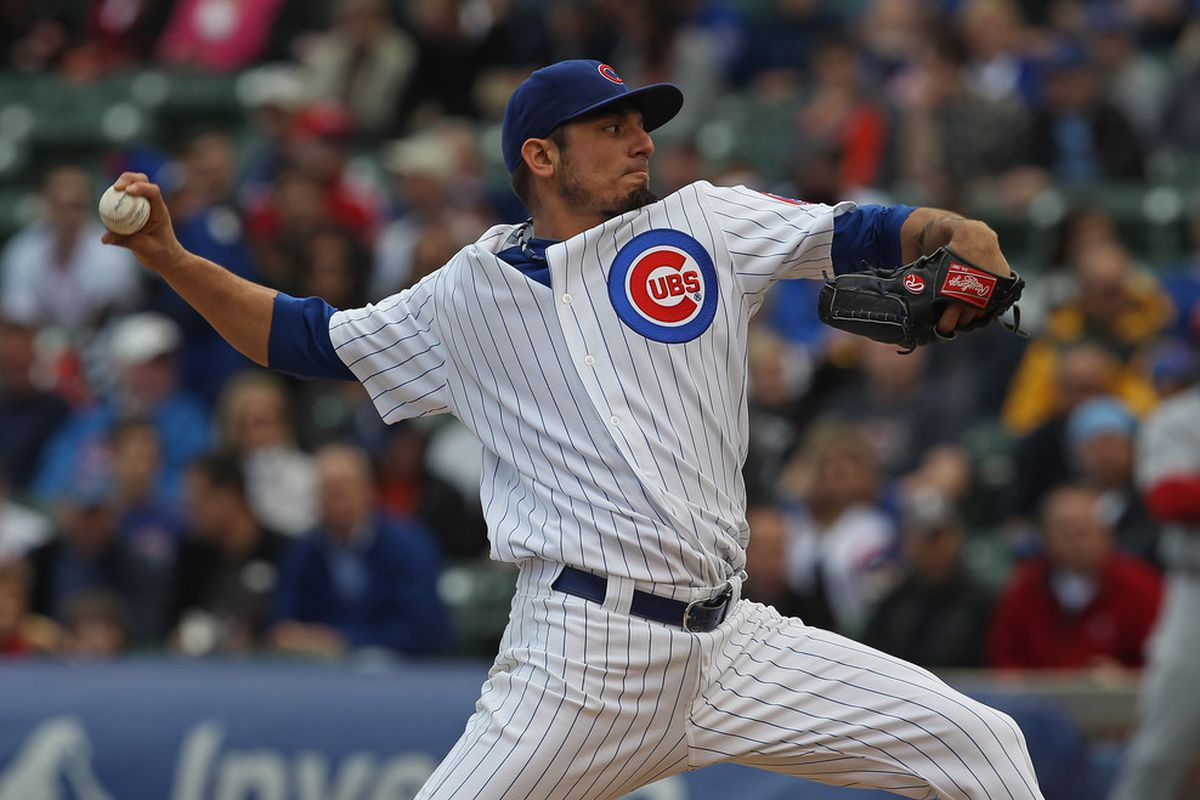 Starting pitcher Matt Garza of the Chicago Cubs delivers the ball against the Cincinnati Reds at Wrigley Field in Chicago, Illinois. (Photo by Jonathan Daniel/Getty Images)