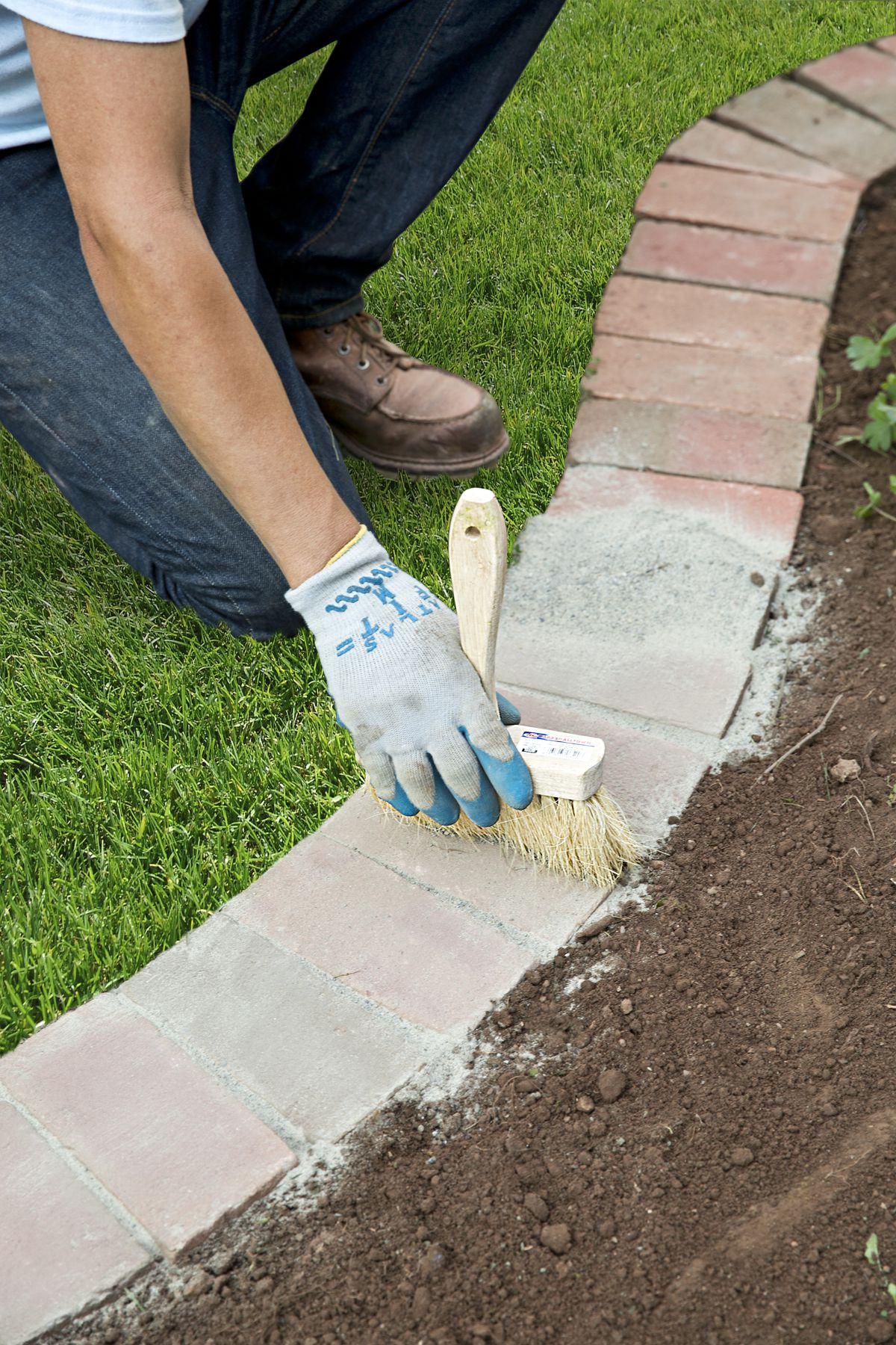 Man Fills Bricks With Polymeric Sand