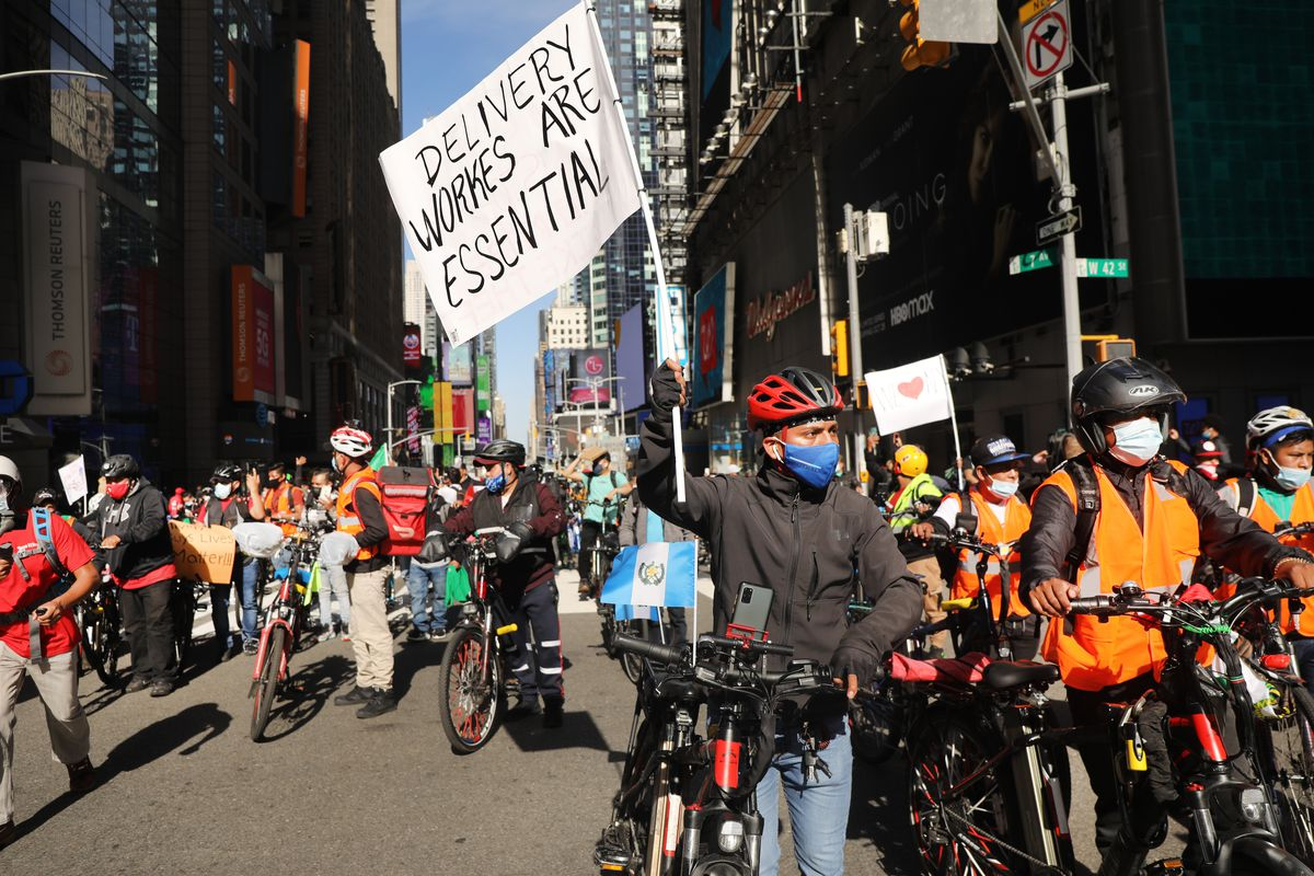 Crowds of delivery workers stand in the street in Manhattan, protesting a surge in the thefts of their bicycles on October 15, 2020 in New York City.