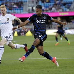 San Jose Earthquakes forward Danny Hoesen (9) shoots next to Real Salt Lake defender Justen Glad during the first half of an MLS soccer match Saturday, June 24, 2017, in San Jose, Calif. (AP Photo/Marcio Jose Sanchez)