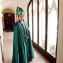 """Bishop Carolyn Tanner Irish stands in St. Paul's Episcopal Church. She returned to Utah in December 1995 as the third woman ever voted to serve as a diocesan bishop in the United States. """"It's been a combination of invention and discovery,"""" she says."""