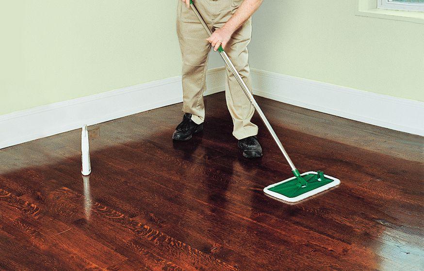 Person Using Microfiber Flat Mop On Hardwood Floor