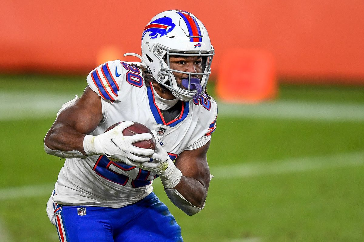 Buffalo Bills running back Zack Moss (20) carries the ball against the Denver Broncos during a game between the Denver Broncos and the Buffalo Bills at Empower Field at Mile High on December 19, 2020 in Denver, Colorado.