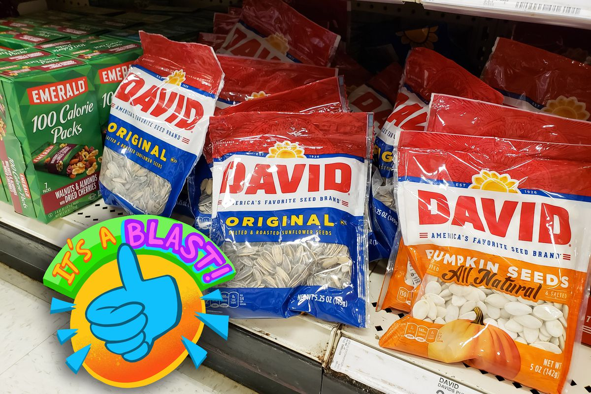 Red, white, and blue bags of David-brand sunflower seeds stock a supermarket shelf alongside orange, white, and blue bags of pumpkin seeds.