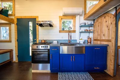 this is a custom design by tiny heirloom for rock climbing lovin homeowners breck and kelsey another highlight is a garage style door that opens the home - Tiny Home Designers