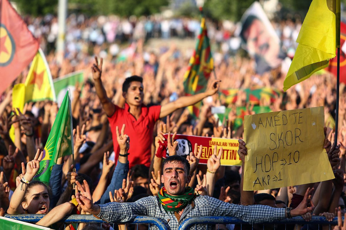 Supporters of the opposition HDP party cheer.