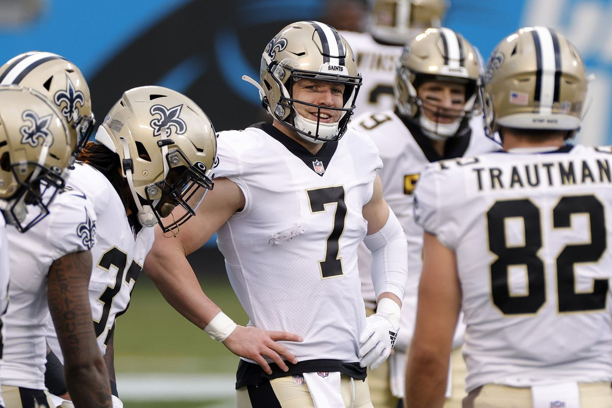 Quarterback Taysom Hill #7 of the New Orleans Saints shares a smile prior to their game against the Carolina Panthers at Bank of America Stadium on January 03, 2021 in Charlotte, North Carolina.