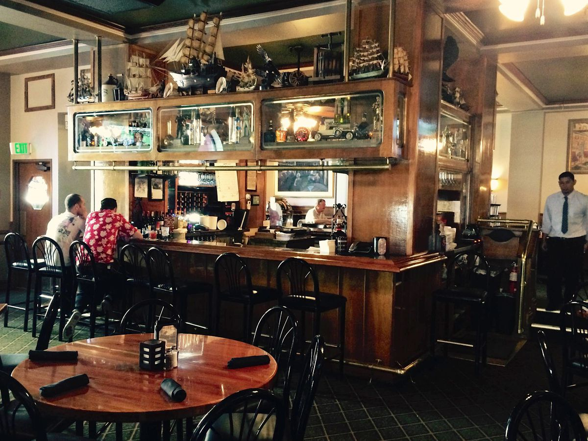Island bar topped with antique bric-a-brac