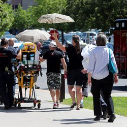 Paramedics take a woman to an ambulance after she collapsed following a Utah County Commission meeting in Provo on Wednesday, July 15, 2020. The woman reportedly had been trying to speak to Tanner Ainge,the commission's chairman, about a state mandate that students in grades K-12 wear masks in schools and felt like she wasn't being listened to.