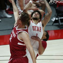 Utah Utes forward Timmy Allen (1) is defended by the Stanford Cardinal in Salt Lake City on Thursday, Jan. 14, 2021. The Utes won 79-65.
