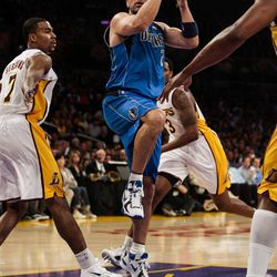 Dallas Mavericks guard Jason Kidd drives to the basket around Los Angeles Lakers center Andrew Bynum during the first half of an NBA basketball game, Sunday, April 15, 2012, in Los Angeles.