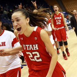 Danielle Rodriguez celebrate's Utah's win over BYU in a women's basketball game at the Marriott Center in Provo on Saturday, Dec. 14, 2013. Utah won in double overtime 82-74.
