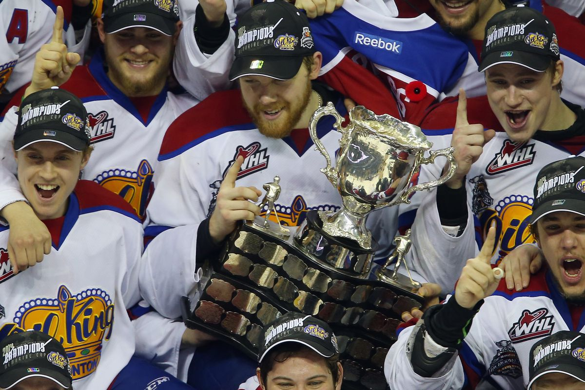 LONDON, ON - MAY 25: Captain Griffin Reinhart #8 of the Edmonton Oil Kings holds the Memorial Cup trophy following a 6-3 victory over the Guelph Storm in the 2014 Memorial Cup championship game at Budweiser Gardens on May 25, 2014 in London, Ontario,