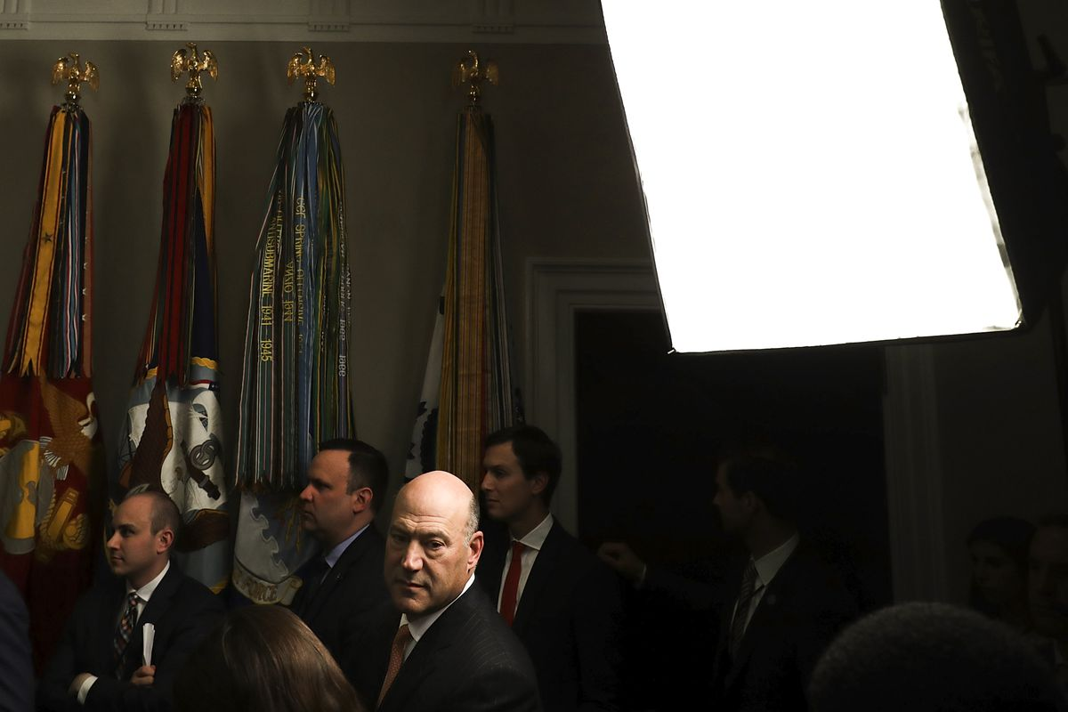 The then White House economic advisor Gary Cohn joins journalists in the back of the Roosevelt Room as President Trump signs the 'Section 232 Proclamations' on steel and aluminum imports on March 8, 2018.