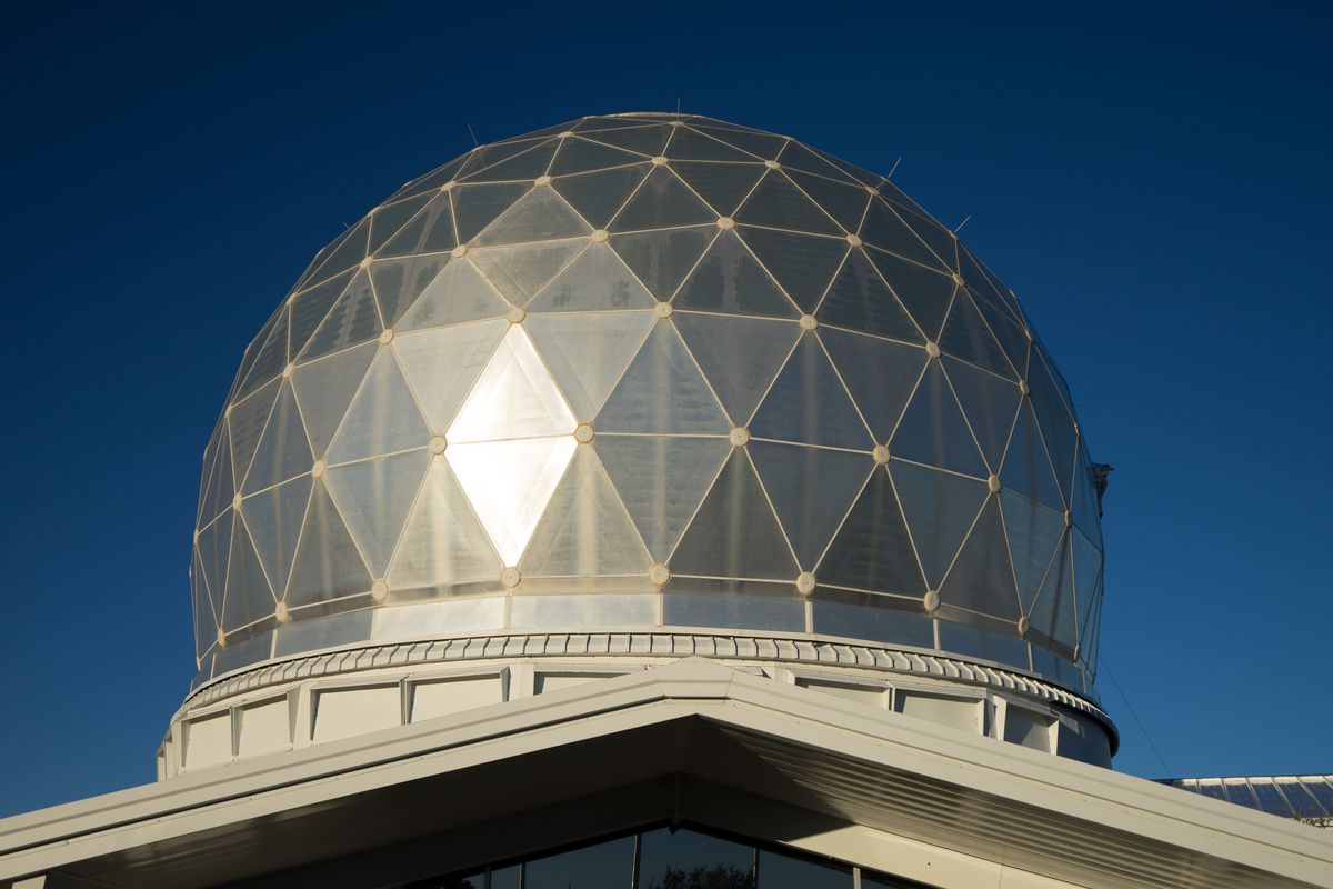 The exterior of McDonald Observatory in Texas. The roof is dome shaped with white structural supports.