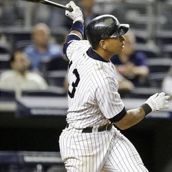 New York Yankees' Alex Rodriguez follows through on a two-run walk-off home run during the 15th inning of a baseball game against the Boston Red Sox Saturday.