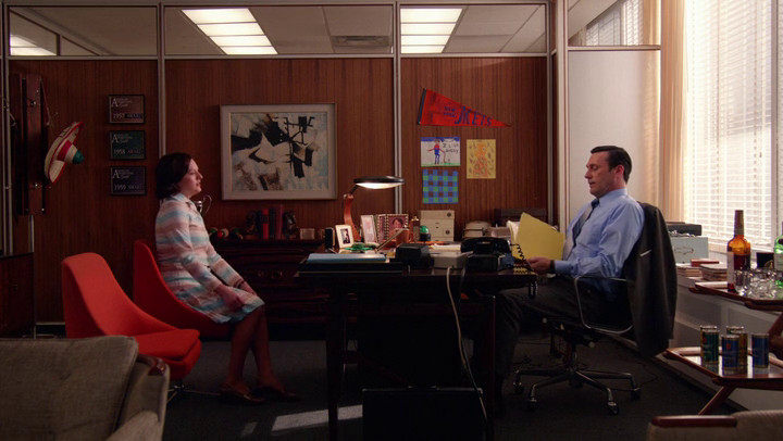 Don gives Peggy a performance review on Mad Men.