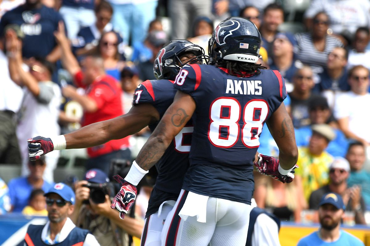Tight end Darren Fells of the Houston Texans and tight end Jordan Akins of the Houston Texans celebrate after a touchdown in the game against the Los Angeles Chargers at Dignity Health Sports Park on September 22, 2019 in Carson, California.