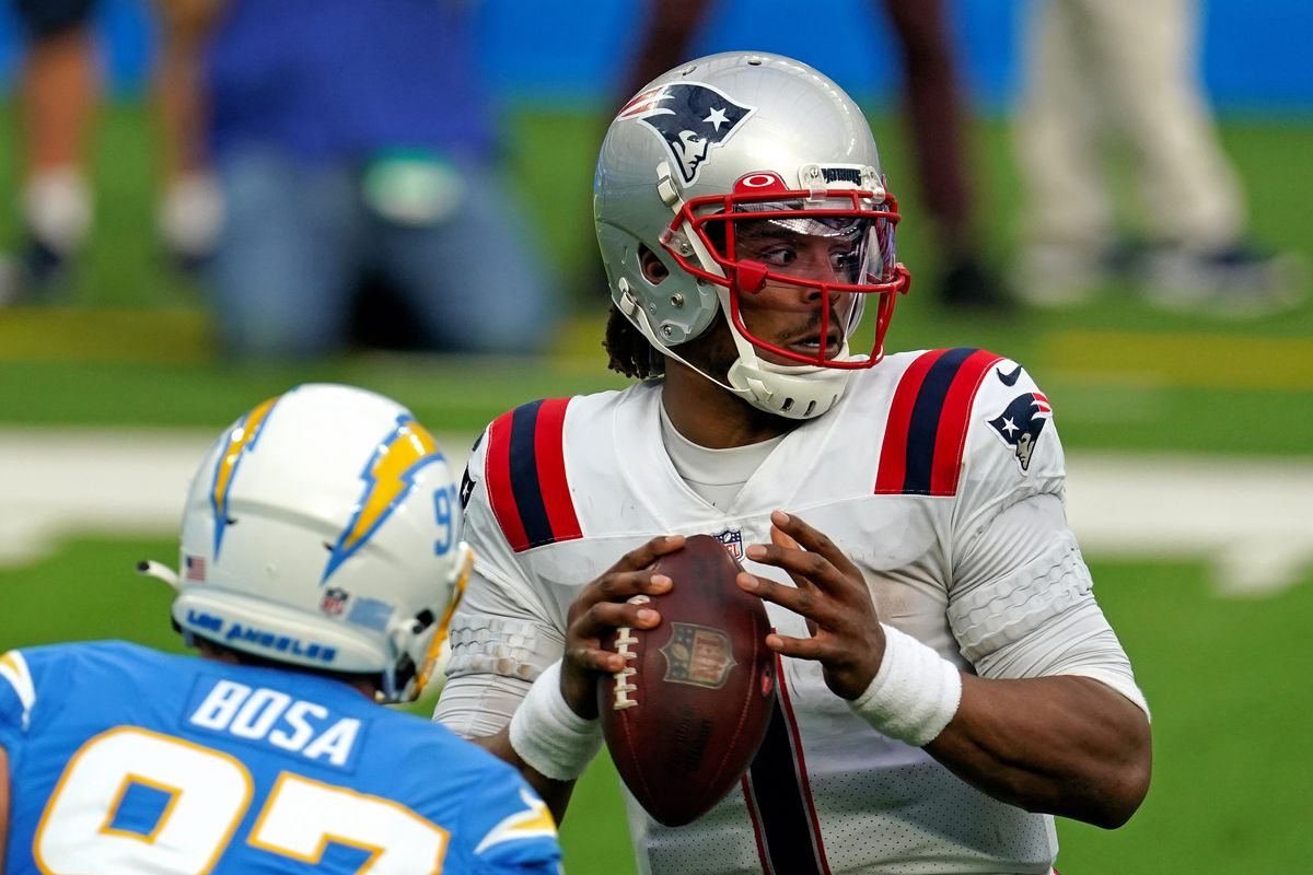 New England Patriots quarterback Cam Newton (1) is pressured by Los Angeles Chargers defensive end Joey Bosa (97) during the first half at SoFi Stadium.