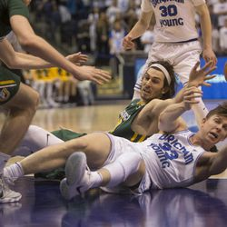 Brigham Young Cougars forward Dalton Nixon (33) and San Francisco Dons forward Matt McCarthy (10) fight for control of the ball during BYU's 75-73 overtime win at the Marriott Center in Provo on Saturday, Feb. 10, 2018.
