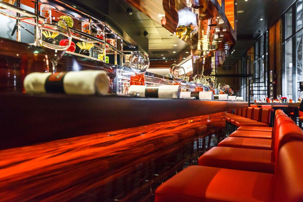 A dark red booth inside a restaurant