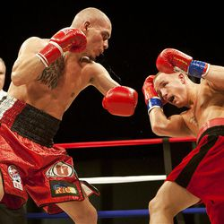 """Chris """"Kid Kayo"""" Fernandez, left, and Allen Litzau fight at the South Towne Expo Center. Fernandez won the bout after six rounds, Saturday, Dec. 15, 2012.at the South Towne Expo Center. Fernandez won the bout after four rounds, Saturday, Dec. 15, 2012."""