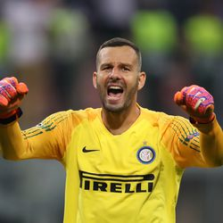 Samir Handanovic of Inter Milan celebrates his team's victory at full-time of the Group B match of the UEFA Champions League between FC Internazionale and Tottenham Hotspur at San Siro Stadium on September 18, 2018 in Milan, Italy.