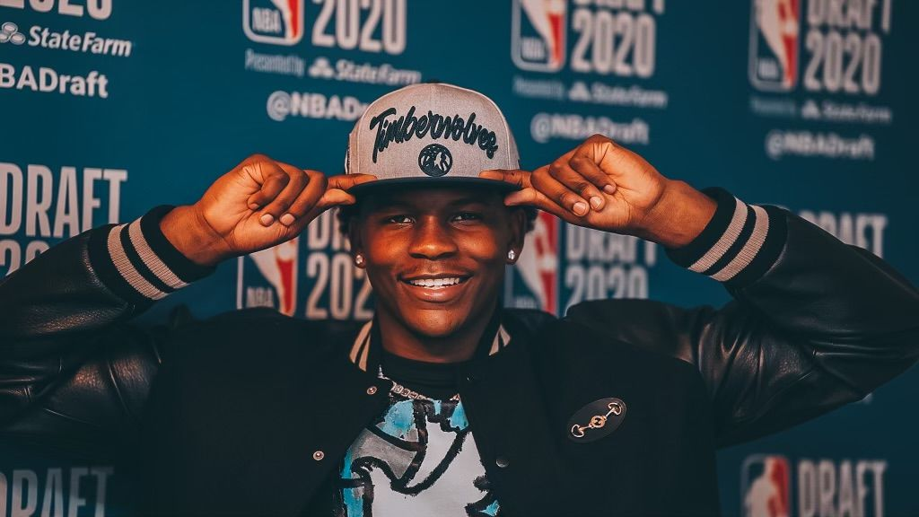 The number one overall pick by the Minnesota Timberwolves, Anthony Edwards poses for a photo with his draft hat during the 2020 NBA Draft on November 18, 2020.