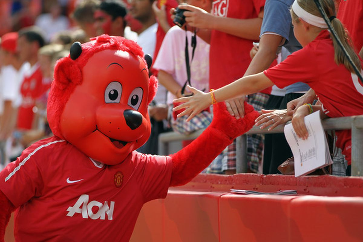 KANSAS CITY MO - JULY 25:  Manchester United mascot Fred the Red greets fans prior to the game against the Kansas City Wizards at Arrowhead Stadium on July 25 2010 in Kansas City Missouri.  (Photo by Jamie Squire/Getty Images)
