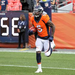 Broncos WR DeAndrew White carries the ball before the preseason game against the Bears.