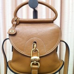 """'90s handcraftedDelvaux leather purse, $395 from <a href=""""http://www.papushka.com/"""">Papushka Vintage</a>"""