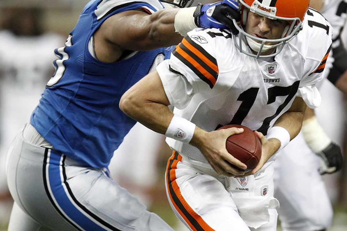 DETROIT - AUGUST 28: Ndamukong Suh #90 of the Detroit Lions grabs the face mask of Jake Delhomme #17 of the Cleveland Browns during a preseason game on August 28 2010 at Ford Field in Detroit Michigan. (Photo by Gregory Shamus/Getty Images)