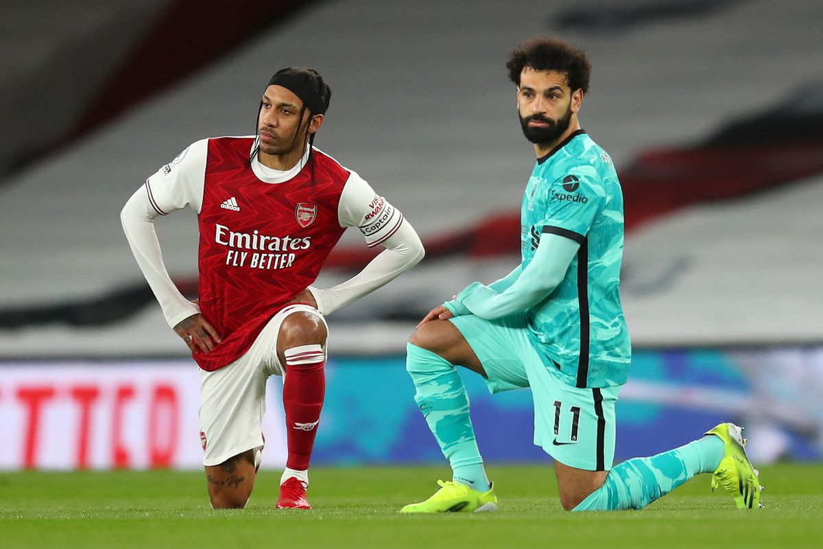 Pierre-Emerick Aubameyang of Arsenal and Mohamed Salah of Liverpool take a knee in support of the Black Lives Matter movement prior to the Premier League match between Arsenal and Liverpool at Emirates Stadium on April 03, 2021